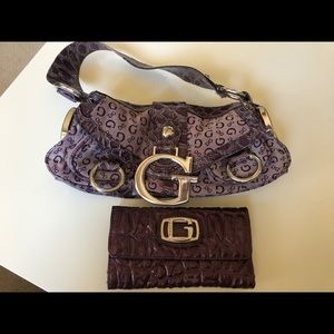 Purple Guess purse and wallet